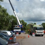 A crane set up for tree removal in Darwin